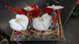 Une composition florale de Noël : un centre de table